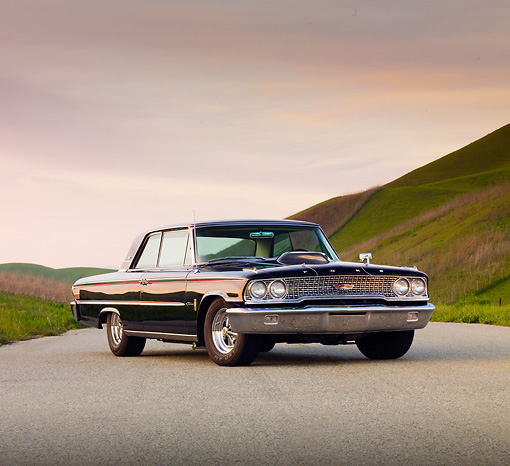 AUT 22 BK0004 01 © Kimball Stock 1963 Ford Galaxie 500 XL Black 3/4 Front View On Pavement By Hills