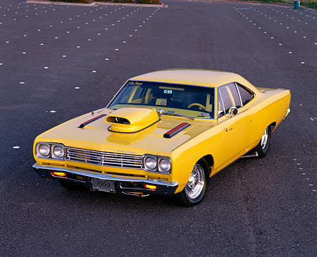 AUT 22 RK0013 04 © Kimball Stock 1969 Plymouth Road Runner Yellow 3/4 Front View On Parking Lot