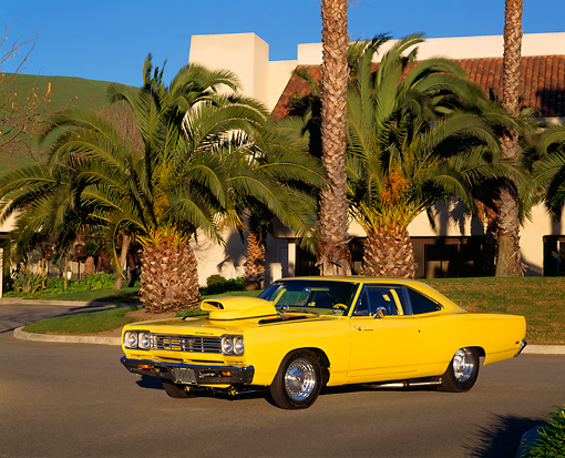 AUT 22 RK0015 02 © Kimball Stock 1969 Plymouth Road Runner Yellow 3/4 Side View In Parking Lot