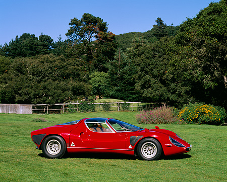 AUT 22 RK0101 01 © Kimball Stock 1968 Alfa Romeo Type 33 Stradale 3/4 Front View On Grass By Trees