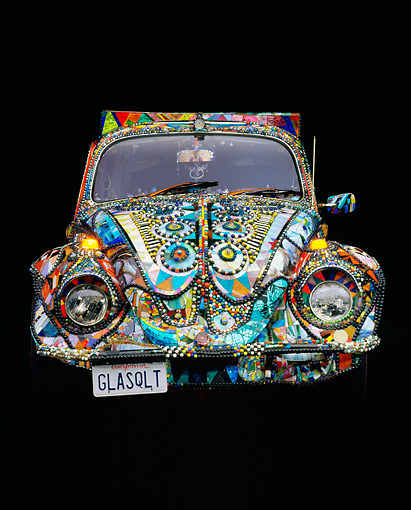 AUT 22 RK0110 14 © Kimball Stock 1969 Volkswagen Beetle Covered With Marbles And Stained Glass Head On Studio