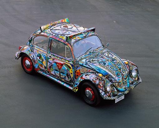 AUT 22 RK0113 04 © Kimball Stock 1969 Volkswagen Beetle Covered In Marbles And Stained Glass Overhead 3/4 Front View On Pavement