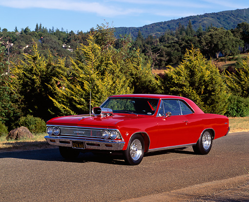 AUT 22 RK0123 03 © Kimball Stock 1966 Chevrolet Malibu Red Front 3/4 View On Pavement By Trees