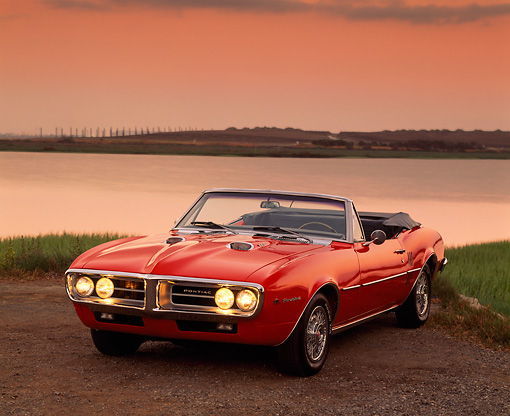 AUT 22 RK0146 08 © Kimball Stock 1967 Pontiac Firebird Convertible Red 3/4 Front View On Pavement By Water Filtered