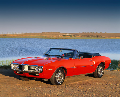 AUT 22 RK0150 02 © Kimball Stock 1967 Pontiac Firebird Convertible Red 3/4 On Dirt By Water