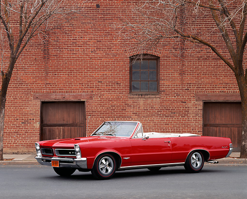 AUT 22 RK0154 01 © Kimball Stock 1965 Pontiac GTO Convertible Red 3/4 Side View On Pavement By Building