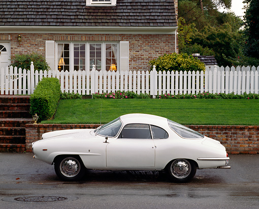 AUT 22 RK0164 02 © Kimball Stock 1966 Alfa Romeo Sprint Speciale White Profile On Pavement By House