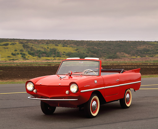AUT 22 RK0185 02 © Kimball Stock 1964 Amphicar Convertible Red 3/4 Front View On Pavement Gray Clouds