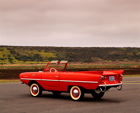 AUT 22 RK0186 01 © Kimball Stock 1964 Amphicar Red 3/4 Rear On Pavement Gray Clouds
