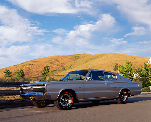 AUT 22 RK0188 04 © Kimball Stock 1966 Dodge Charger 426 Hemi Silver Low 3/4 Side View On Pavement Dry Grass Hills