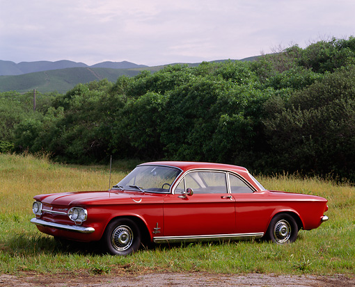 AUT 22 RK0223 01 © Kimball Stock 1962 Chevrolet Corvair Monza Spyder Red 3/4 Side View On Grass