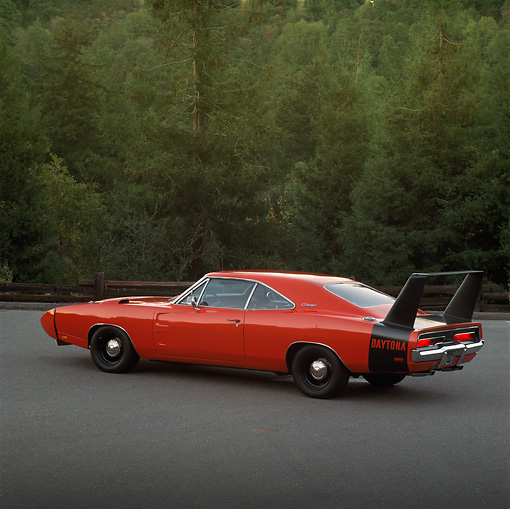 AUT 22 RK0265 01 © Kimball Stock 1969 Dodge Daytona Charger Red 3/4 Rear View On Pavement By Trees