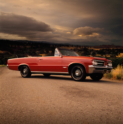 AUT 22 RK0271 02 © Kimball Stock 1964 Pontiac GTO Convertible Red 3/4 Side View On Pavement