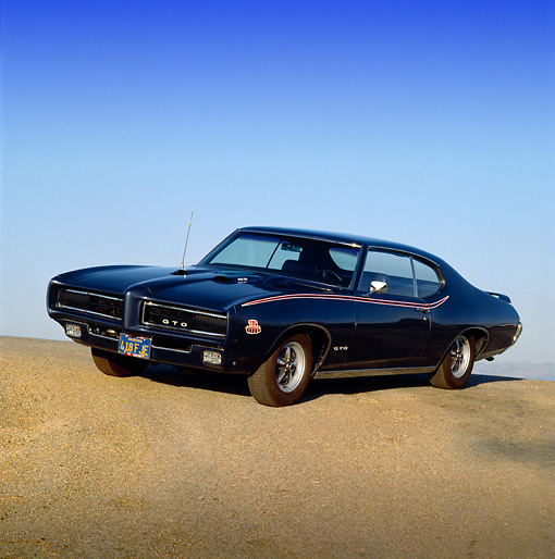 AUT 22 RK0278 01 © Kimball Stock 1969 Pontiac GTO Black 3/4 Front View On Pavement Hill