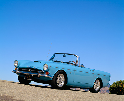 AUT 22 RK0286 05 © Kimball Stock 1965 Sunbeam Tiger Convertible Light Blue 3/4 Side View On Pavement