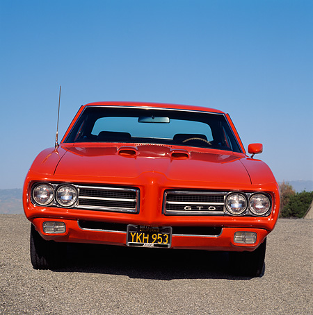 AUT 22 RK0320 02 © Kimball Stock 1969 Pontiac GTO Convertible The Judge Red Head On Shot On Pavement