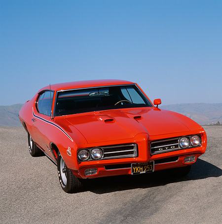 AUT 22 RK0325 02 © Kimball Stock 1969 Pontiac GTO Convertible The Judge Red Front 3/4 View On Pavement Hill Blue Sky