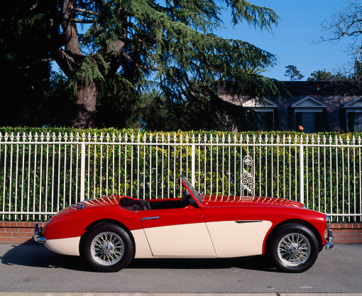 AUT 22 RK0337 04 © Kimball Stock 1960 Austin-Healey 3000 Mark 1 BN-7 Red And White Profile View On Pavement