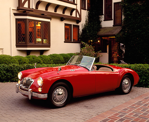 AUT 22 RK0339 05 © Kimball Stock 1962 MG MGA 1600 Mark 2 Convertible Red 3/4 Front View On Pavement By House