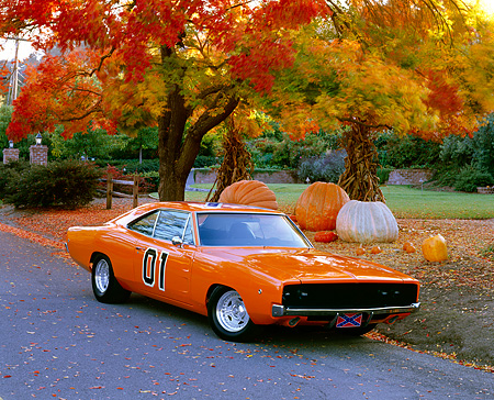 AUT 22 RK0976 03 © Kimball Stock 1969 Dodge Charger 440 Orange 3/4 Front View On Pavement By Fall Trees And Pumpkins