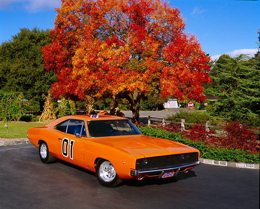 AUT 22 RK0979 06 © Kimball Stock 1969 Dodge Charger 440 Orange 3/4 Front View On Pavement By Fall Trees