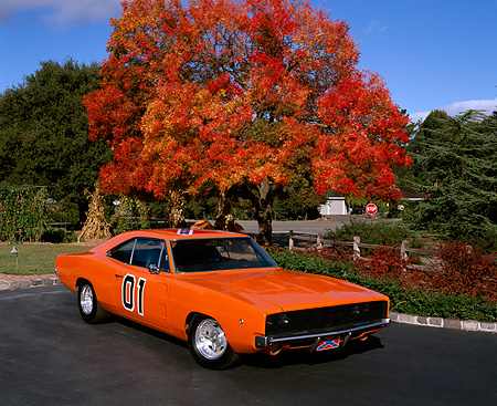 AUT 22 RK0979 07 © Kimball Stock 1969 Dodge Charger 440 Orange 3/4 Front View On Pavement By Fall Trees