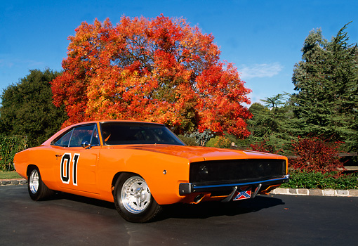 AUT 22 RK0987 04 © Kimball Stock 1968 Dodge Charger 440 Orange Low 3/4 Front View On Pavement By Autumn Tree Blue Sky