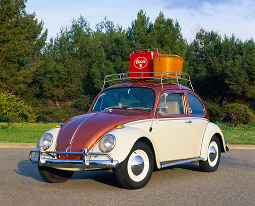 AUT 22 RK1006 01 © Kimball Stock 1965 VW Beetle Steel Sunroof Copper And White 3/4 Front View On Pavement With Basket On Top By Trees