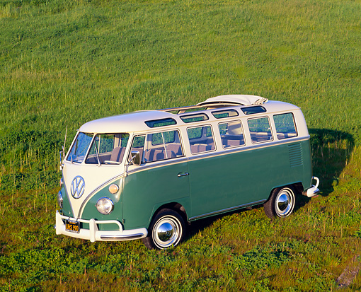 AUT 22 RK1035 03 © Kimball Stock 1966 VW Deluxe Bus Green And White 3/4 Side View On Grass Hill