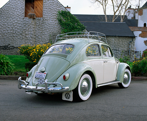 AUT 22 RK1052 01 © Kimball Stock 1960 Volkswagen Beetle Green And Cream 3/4 Rear View On Pavement By Stone Building