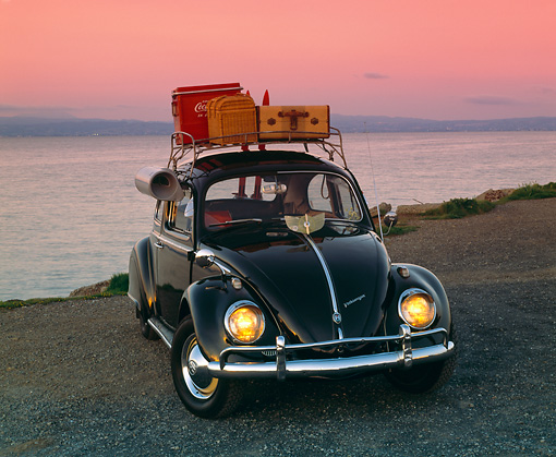 AUT 22 RK1060 05 © Kimball Stock 1960 VW Beetle Black With Roof Rack 3/4 Front View On Pavement By Water Filtered