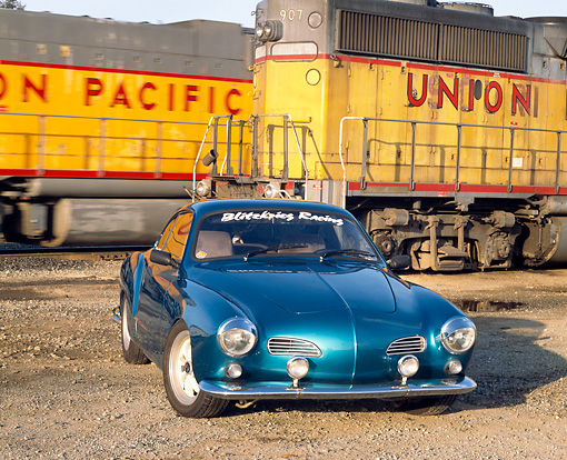 AUT 22 RK1070 01 © Kimball Stock 1967 Karmann Ghia Turquoise Front 3/4 View By Trains