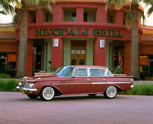 AUT 22 RK1166 02 © Kimball Stock 1961 AMC Rambler Ambassador Custom Red 3/4 Side View By Restaurant