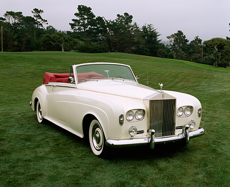 AUT 22 RK1218 07 © Kimball Stock 1963 Rolls-Royce Silver Cloud III Convertible White 3/4 Front View On Grass Trees Background