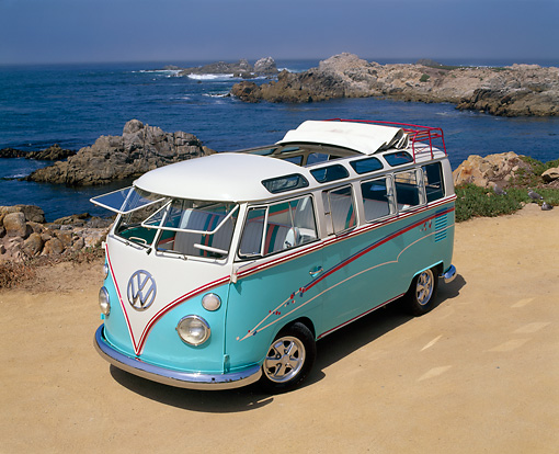 AUT 22 RK1219 08 © Kimball Stock 1967 Volkswagen 21-Window Bus Ragtop Light Blue And White Overhead 3/4 Front View On Sand By Ocean