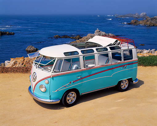 AUT 22 RK1220 01 © Kimball Stock 1967 Volkswagen Bus Ragtop 21-Window Light Blue/White Overhead 3/4 Front View On Sand By Water