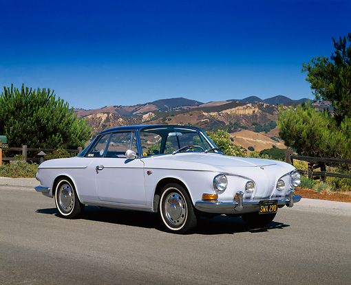 AUT 22 RK1243 03 © Kimball Stock 1966 VW Type 3 Karmann Ghia Light Blue 3/4 Front View On Pavement Trees And Mountains