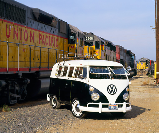 AUT 22 RK1264 09 © Kimball Stock 1964 Volkswagen Bus Black And White Front 3/4 View On Dirt By Train