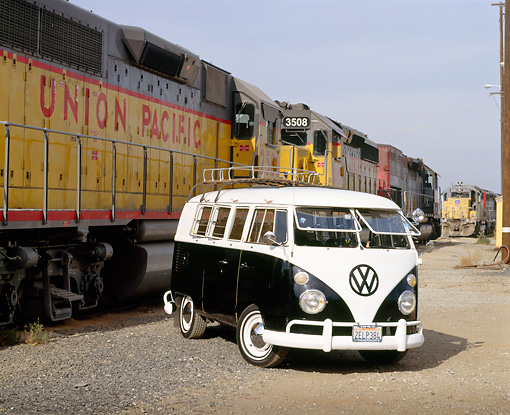 AUT 22 RK1264 10 © Kimball Stock 1964 Volkswagen Bus Black And White Front 3/4 View On Dirt By Train