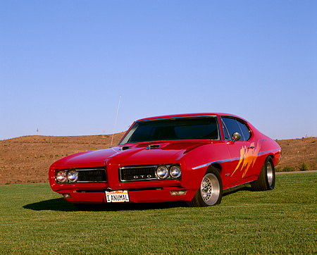 AUT 22 RK1269 01 © Kimball Stock 1968 Pontiac GTO Red Custom Design 3/4 Front View On Grass Hills Blue Sky