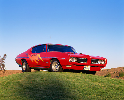 AUT 22 RK1270 02 © Kimball Stock 1968 Pontiac GTO Red Custom Design Low 3/4 Front View On Grass Hill