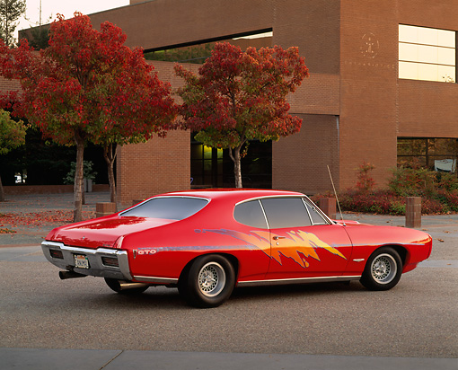 AUT 22 RK1277 02 © Kimball Stock 1968 Pontiac GTO Red Custom Design 3/4 Rear View On Pavement