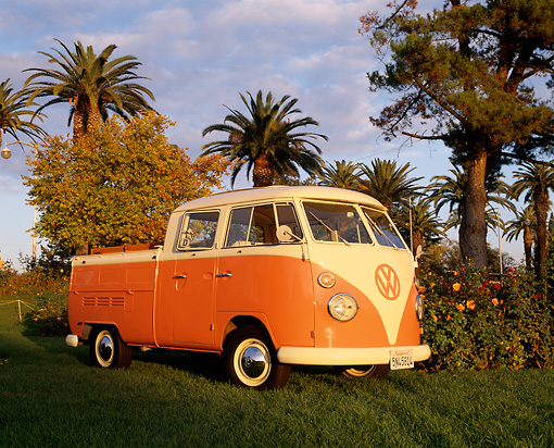 AUT 22 RK1278 05 © Kimball Stock 1967 VW Crew Cab With Sunroof Peach And White 3/4 Side View On Grass By Trees Blue Sky
