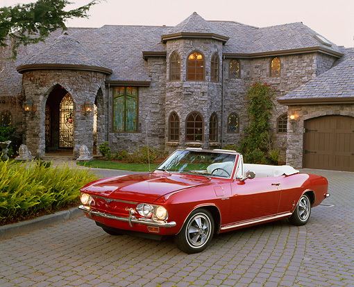 AUT 22 RK1318 04 © Kimball Stock 1966 Chevrolet Corvair Turbo Corsa Convertible Red 3/4 Front View On Driveway By House