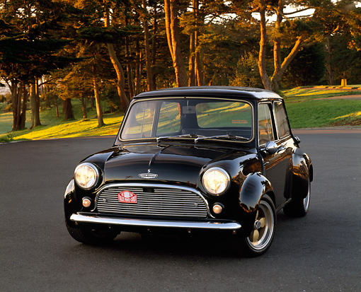 AUT 22 RK1334 01 © Kimball Stock 1962 Austin Mini Cooper Black 3/4 Front View On Pavement By Trees