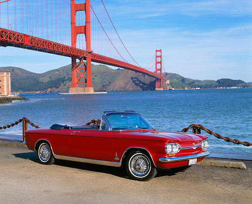AUT 22 RK1367 02 © Kimball Stock 1964 Chevrolet Corvair Monza Spyde Red 3/4 Side View On Dirt SF Bridge