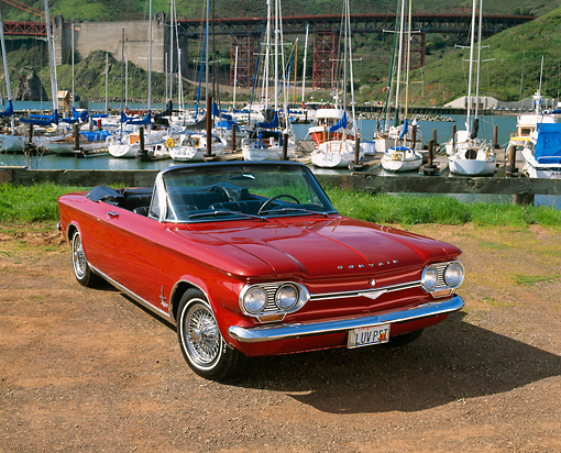 AUT 22 RK1370 01 © Kimball Stock 1964 Chevrolet Corvair Monza Spyder Red 3/4 Front View On Dirt By Marina