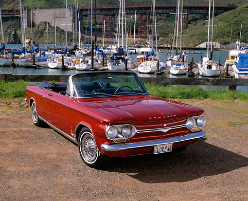 AUT 22 RK1370 02 © Kimball Stock 1964 Chevrolet Corvair Monza Spyder Red 3/4 Front View On Dirt By Marina