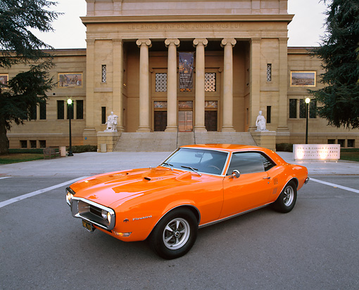 AUT 22 RK1407 03 © Kimball Stock 1968 Pontiac Firebird Orange 3/4 Front View On Pavement By Building