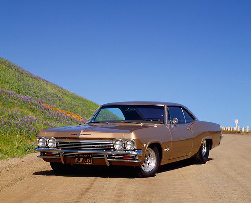 AUT 22 RK1470 02 © Kimball Stock 1965 Chevrolet Impala SS Prostreet Gold 3/4 Front View On Dirt By Hill